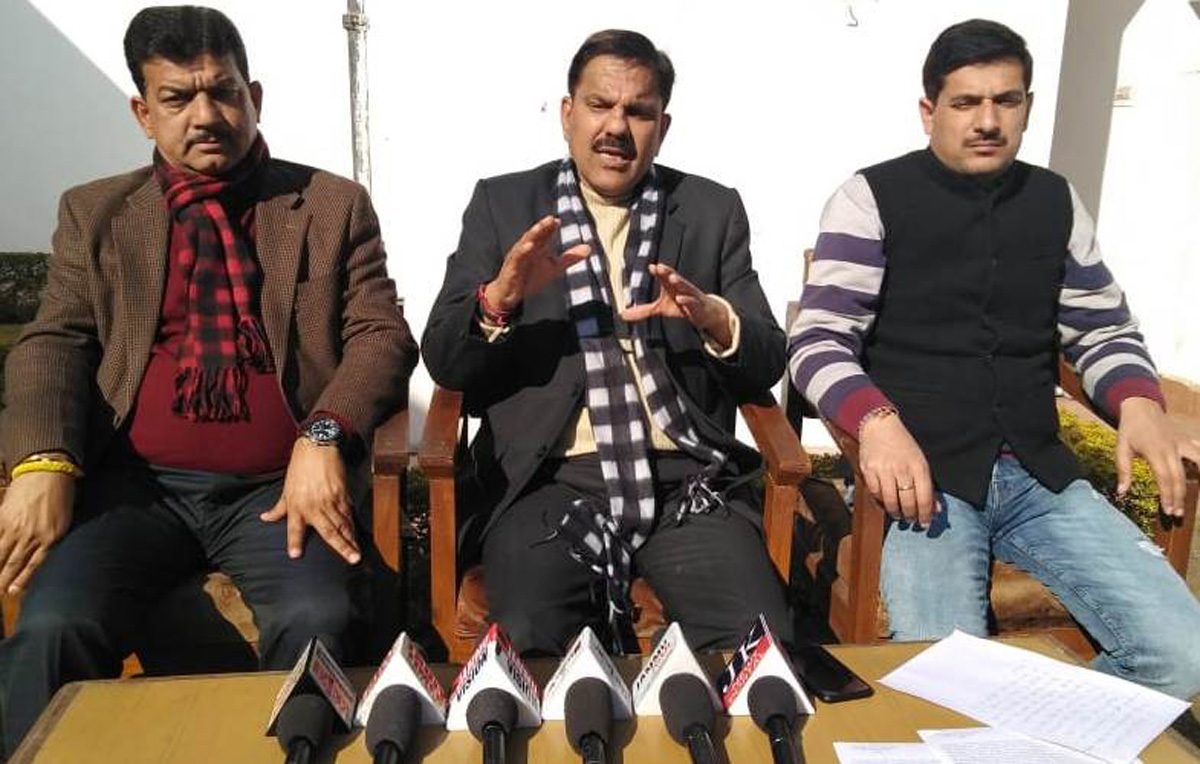 Harsh Dev Singh, JKNPP chairman along with other party leaders addressing a press conference.