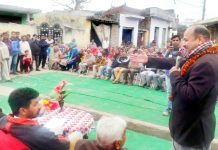 Senior Cong leader M K Bhardwaj addressing a gathering in Bishnah on Sunday.