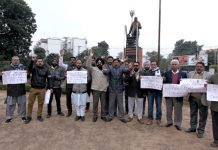 Activists of SC/ST/OBC Confederation and NSOSYF staging protest in Jammu on Sunday.
