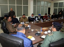 Traffic Police officers and office bearers of Mini-Buses Transport Unions during meeting at Jammu on Tuesday.