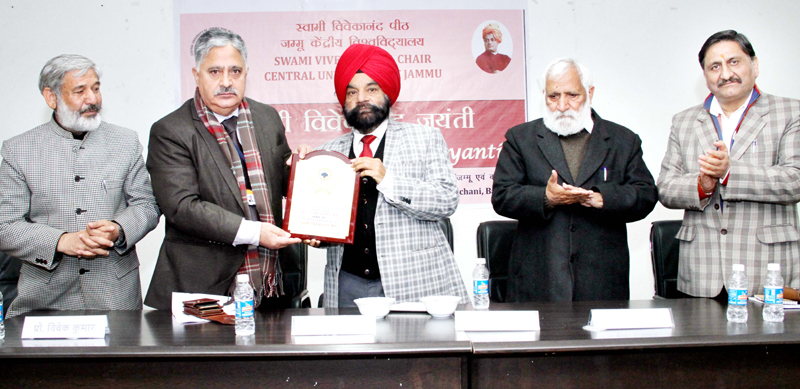 CUJ VC presenting memento to Chancellor, Central University of Himachal Pradesh during function to celebrate birth anniversary of Swami Vivekanand on Friday.