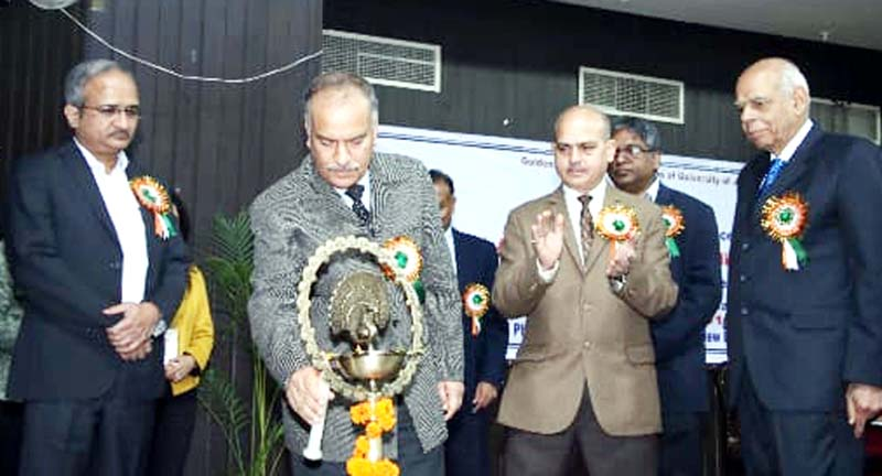 JU VC lighting ceremonial lamp in presence of guests during international conference on Friday.