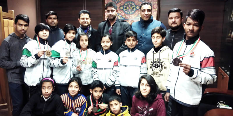 Medal winners, Secretary, J&K State Sports Council Dr Naseem Chowdhary and officials of Wushu Association of J&K posing for group photograph at Jammu.