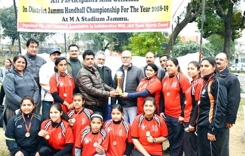Dignitaries awarding the winner team of Handball Championship at MA Stadium Jammu on Wednesday.