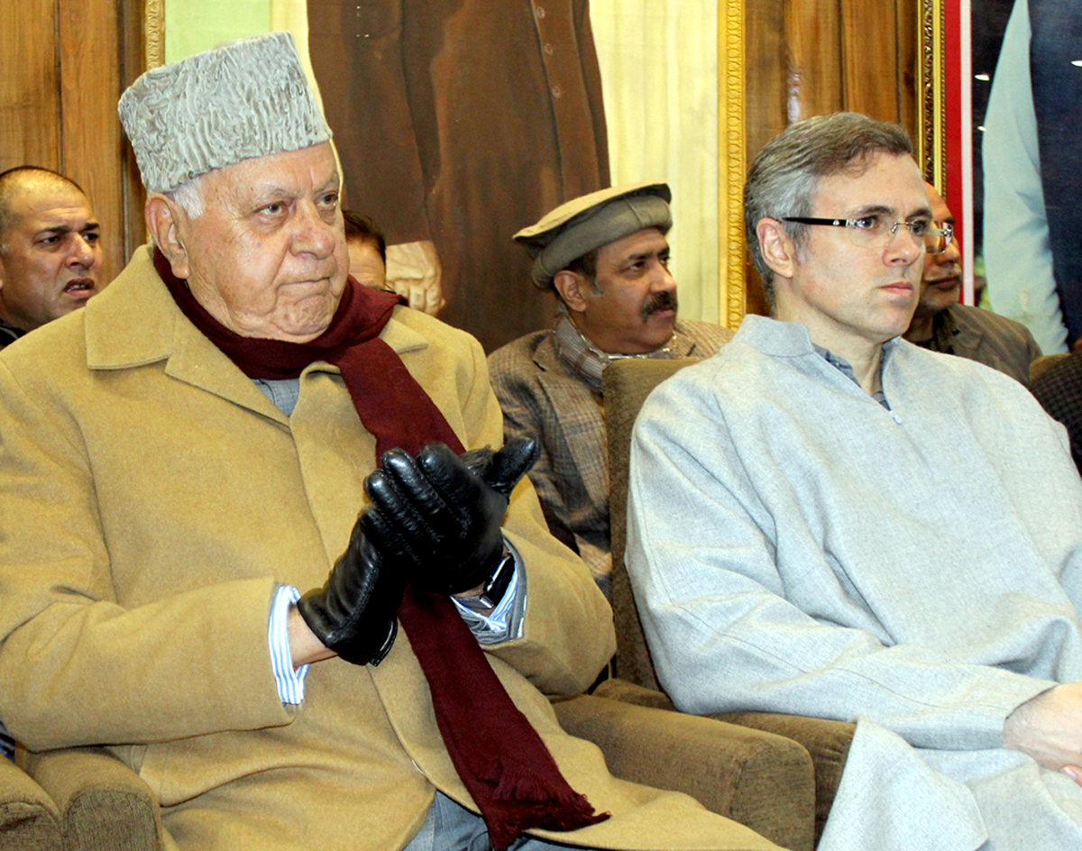 NC president Dr Farooq Abdullah along with Omar Abdullah addressing a gathering at party headquarters in Srinagar on Monday. -Excelsior/Shakeel