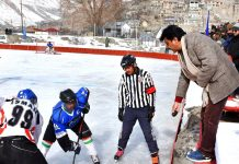 Players in action during 11th CEC Ice Hockey Championship at Kargil.