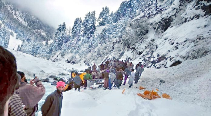 Dead bodies of avalanche victims being removed to Pahalgam by the villagers. -Excelsior/Sajad Dar