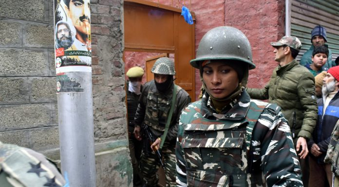 Para-military personnel during raids at Maisuma house of Yasin Malik in Srinagar on Tuesday. -Excelsior/Shakeel