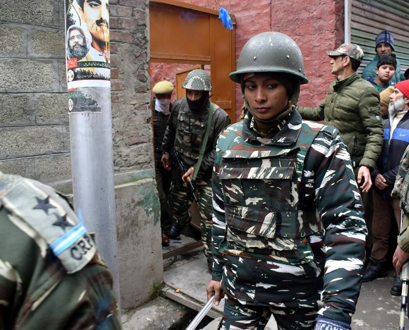 Para-military personnel during raids at Maisuma house of Yasin Malik in Srinagar on Tuesday. -Excelsior/Shakeel