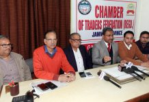 President Chamber of Traders Federation, Neeraj Anand addressing a press conference at Jammu on Wednesday.