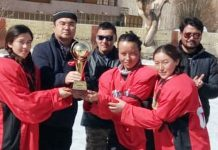 Winners of Women's Ice Hockey Tournament receiving Trophy from the dignitaries in Leh.