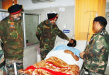 Northern Army Comdr Lt Gen. Ranbir Singh enquiring about health of an injured soldier in Base Hospital at Srinagar.