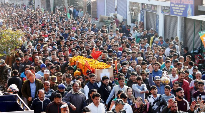 Mourners carrying mortal remains of martyr DySP of JKP Aman Thakur to cremation ground on Monday. -Excelsior/Rakesh