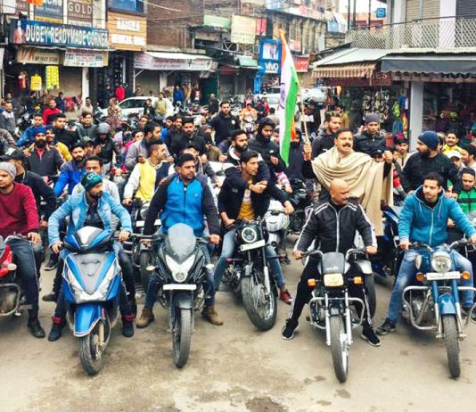NPP leader Balwant Singh Mankotia leading a bike rally at Udhampur on Monday to protest Pulwama terror attack.