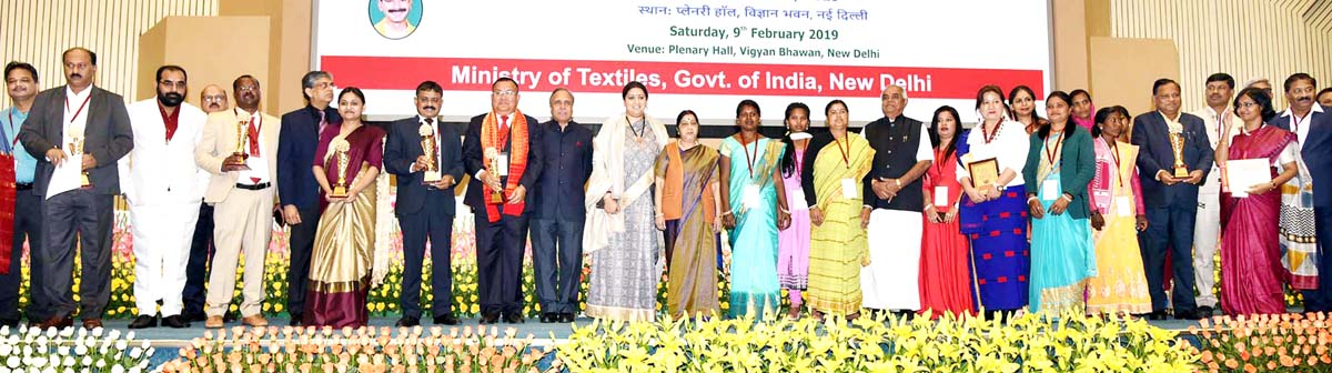Three J&K Silkworm rearers and other awardees along with Union Ministers Simriti Irani and Sushma Swaraj at a function in Delhi.