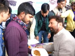 DSS president, Ch Lal Singh serving langar at GMC Hospital Jammu on Monday.