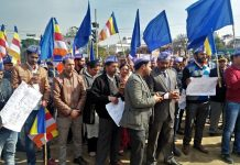 People belonging to SC, ST and OBC categories staging protest at Ambedkar Chowk in Jammu.