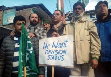 PDP MLC leading a protest on Sunday.