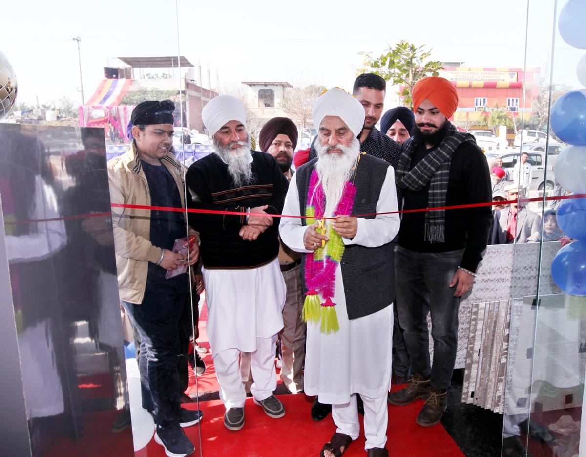 Mahant Manjeet Singh Ji inaugurating a tiles and sanitary ware showroom at Digiana in Jammu. -Excelsior/Rakesh