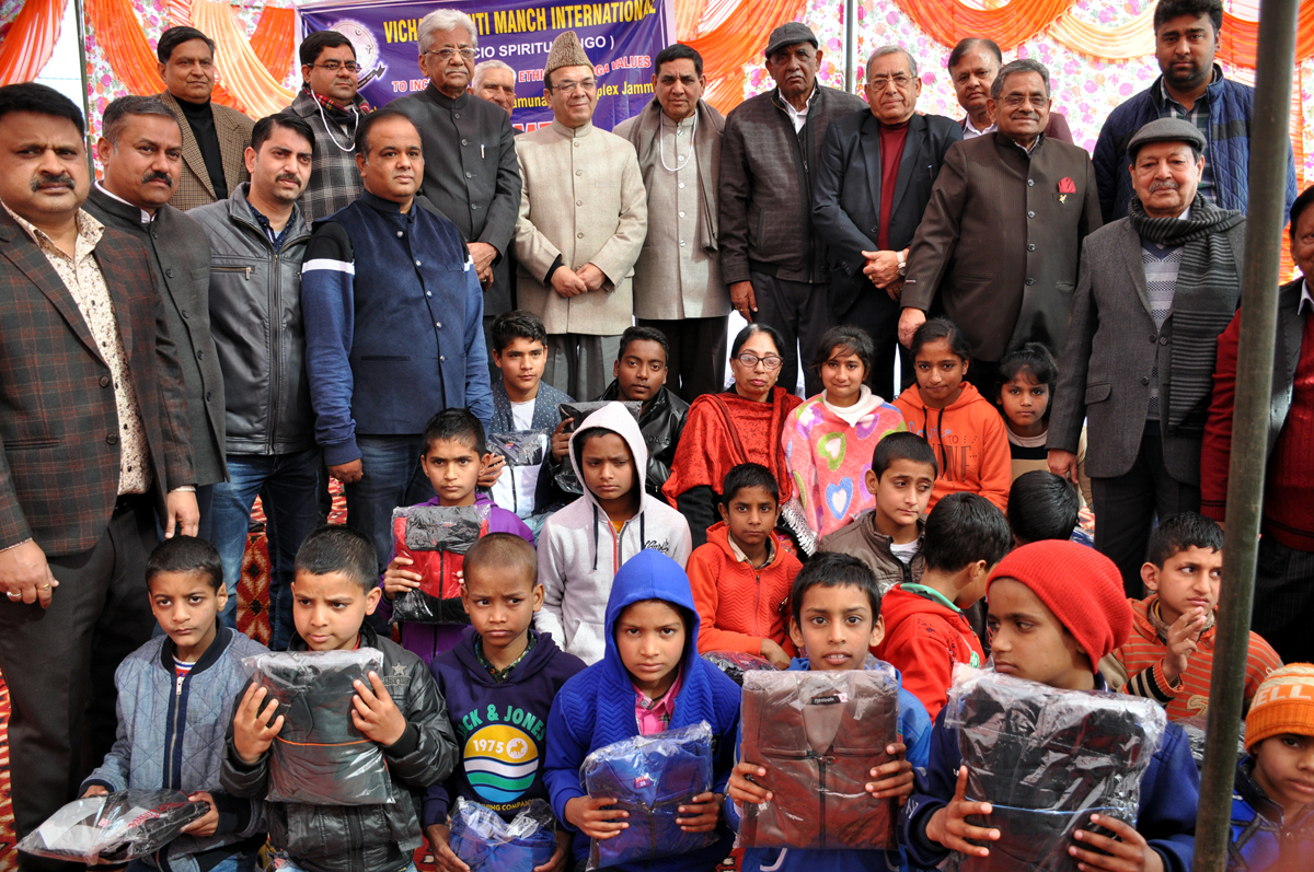 VKMI members and guests with children who were given blankets during a function at Jammu on Sunday.