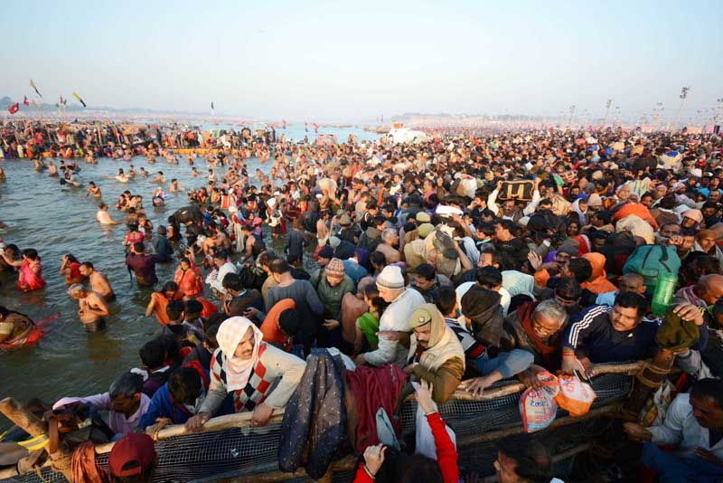Devotees take holy dip on occassion of Basant Panchami Shahi Snan at Sangam during on going Kumbh Mela in Prayagraj on Sunday. (UNI)