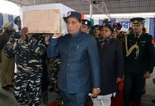 Union Home Minister Rajnath Singh carrying coffin of a CRPF jawan in Srinagar on Friday.