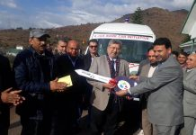 JK Bank officials handing over key of ambulance to BGSBU, Rajouri on Friday.