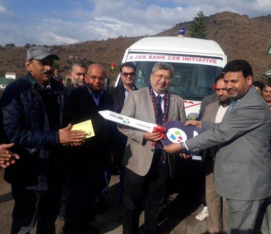 JK Bank officials handing over key of ambulance to BGSBU, Rajouri on Friday.