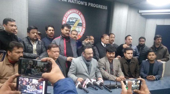 Chamber president Rakesh Gupta addressing a press conference in Jammu on Thursday.