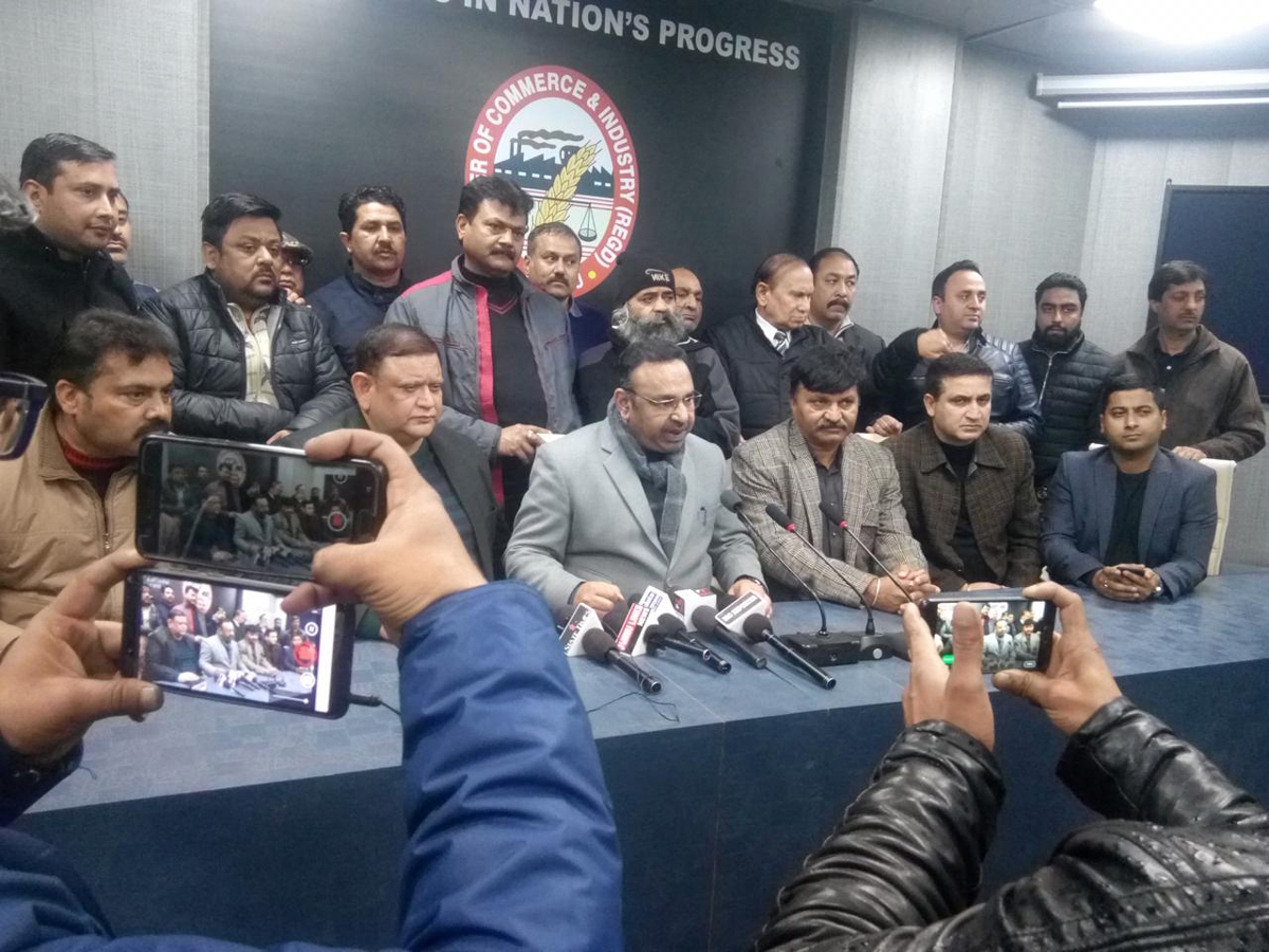 Chamber president Rakesh Gupta addressing a press conference in Jammu on Thursday.