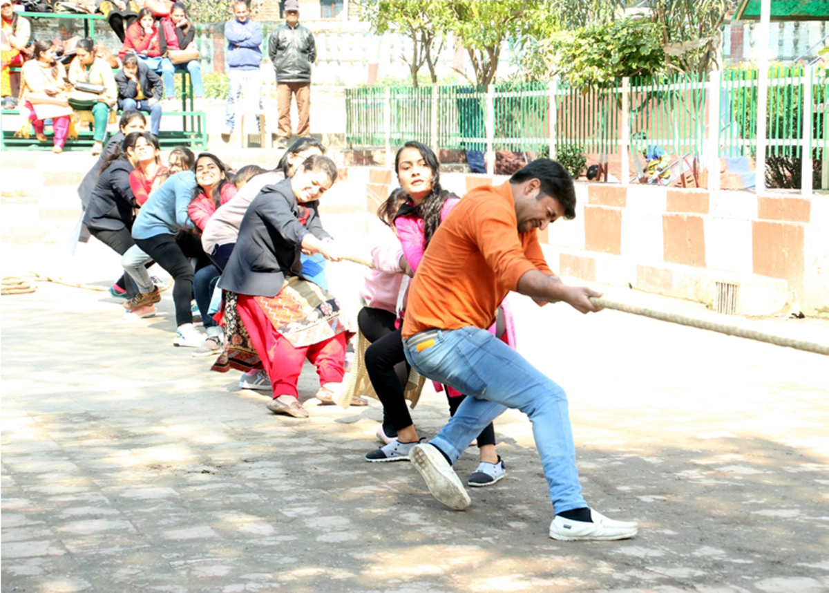 Students in action during Tug of War event at MIER College of Education.