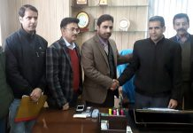 New Director Information Gulzar Ahmed Shabnam with officers of the department.