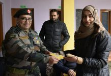 An army officer giving prize to a student at Sopore on Thursday.