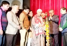 Dignitaries lighting the lamp during a function at Jammu on Friday. -Excelsior/Rakesh
