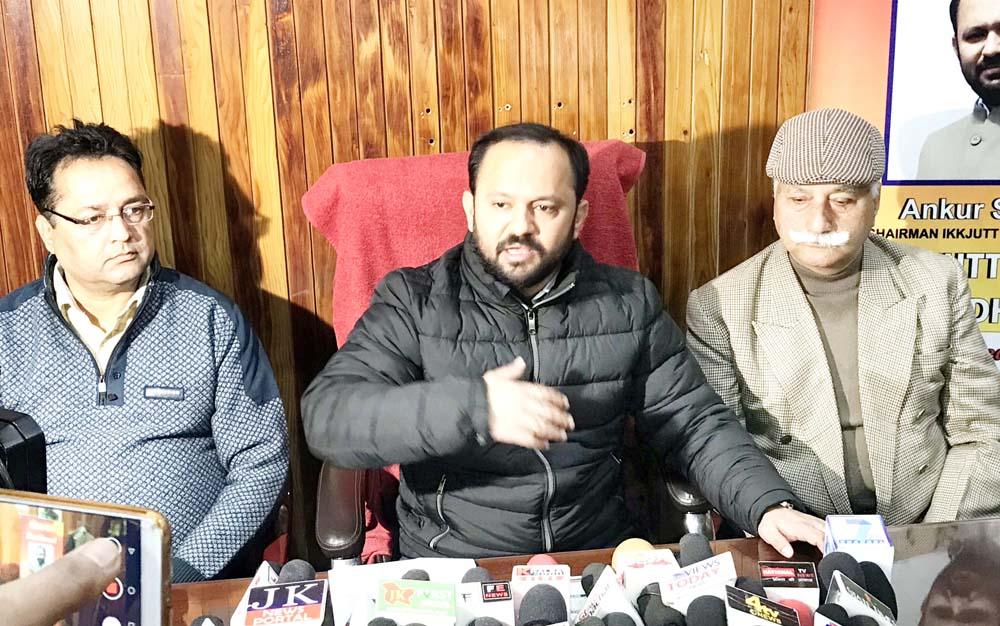 Ankur Sharma addressing a press conference at Jammu on Friday.