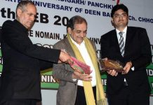 Union Minister of Steel Birender Singh felicitating Gourav Abrol Director MV Internation School in Jammu.