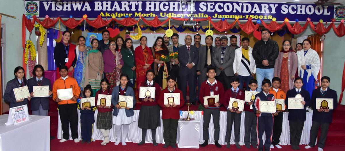 Winners of Inter-School Solo Bhajan Gayan Pratiyogita posing along with dignitaries and officials in Jammu.