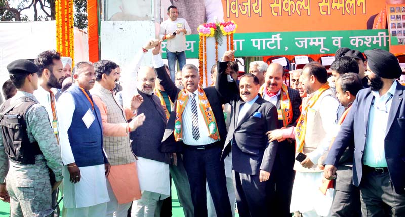 Former Bar President, Abhinav Sharma with BJP national President, Amit Shah & Union Minister, Dr Jitendra Singh waiving the crowd after joining BJP at Jammu on Sunday.