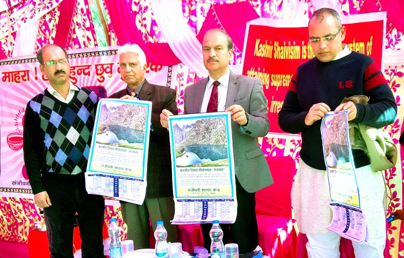 Prof Manoj Dhar, VC JU and other dignitaries releasing Annual Calendar of Sanjeevani Shardha Kendra at Jagti in Jammu.