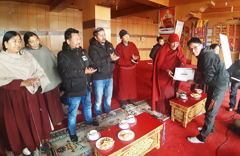 Participating students and elders receiving certificates at Leh. — Excelsior/Morup Stanzin