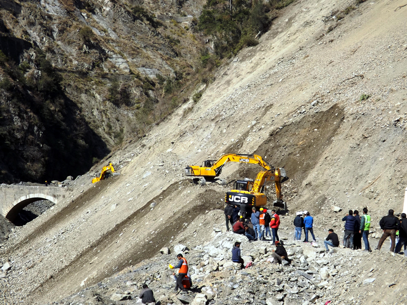 Picture shows Maroog landslide and people at the area in Ramban on Monday. -Excelsior/Parvaiz Mir