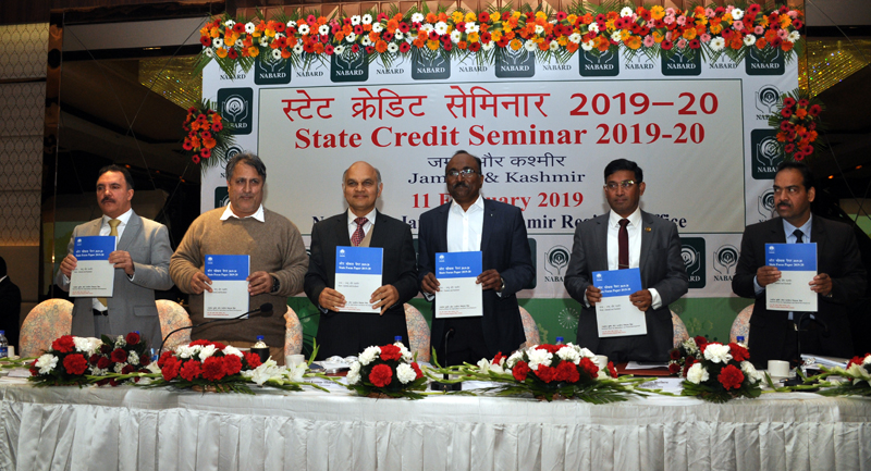 Advisor Kewal Kumar Sharma and others at State Credit Seminar of NABARD on Monday.