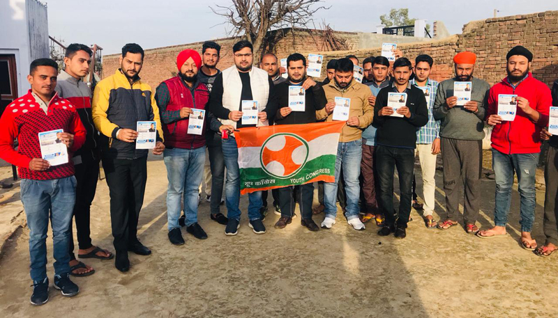 Youth Congress leaders and activists posing for a group photograph during 'Chalo Panchayat Abhiyaan' programme at RS Pura in Jammu.