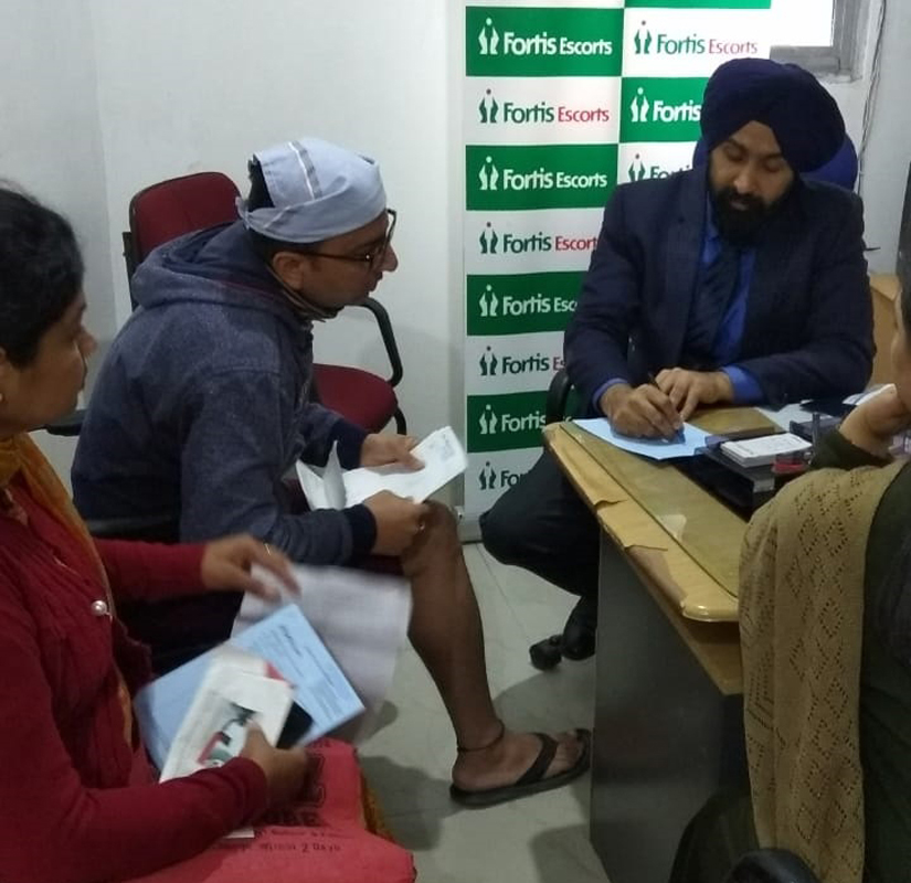 Dr Ranjit Singh from Fortis Escorts Hospital Amritsar attending patients during a knee checkup camp at Nanak Nagar Gurdwara in Jammu.