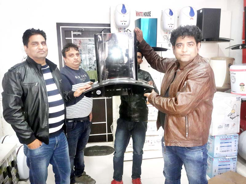Owners of White House Showroom Kamal Kishore and Kewel Krishan launching all new chimneys for modern kitchen at Jammu.