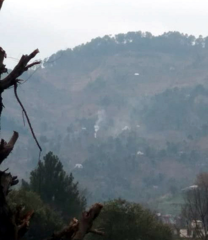 Smoke billows out of mortar shells fired by Pakistan army in Jhallas area of Poonch on Tuesday. -Excelsior/Harbhajan