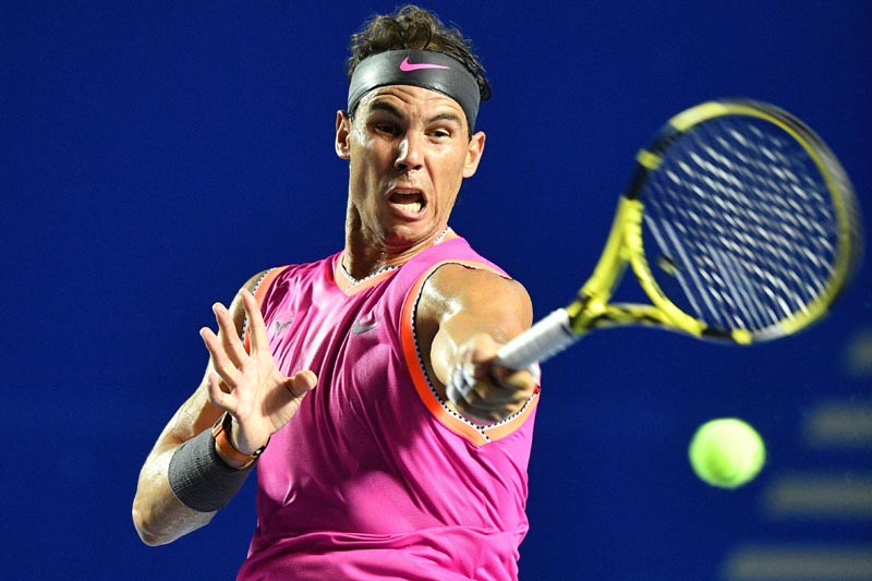 Rafael Nadal of Spain hits a return during the men's singles first round match against Mischa Zverev of Germany at the 2019 Mexican Open Tennis tournament in Acapulco, Mexico.