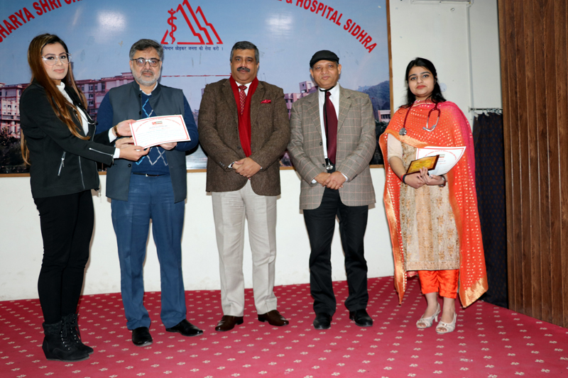 An intern being presented certificate of participation at ASCOMS in Jammu.