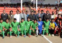 Young footballers posing along with Advisor K Vijay Kumar and other dignitaries during inaugural ceremony of Santosh Trophy at Katra.