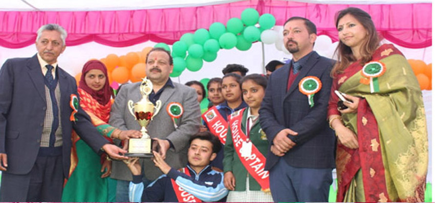 Provincial President National Conference Devender Singh Rana felicitating students during Annual Day Function of Chandi Public School at Ranjan in Jammu.